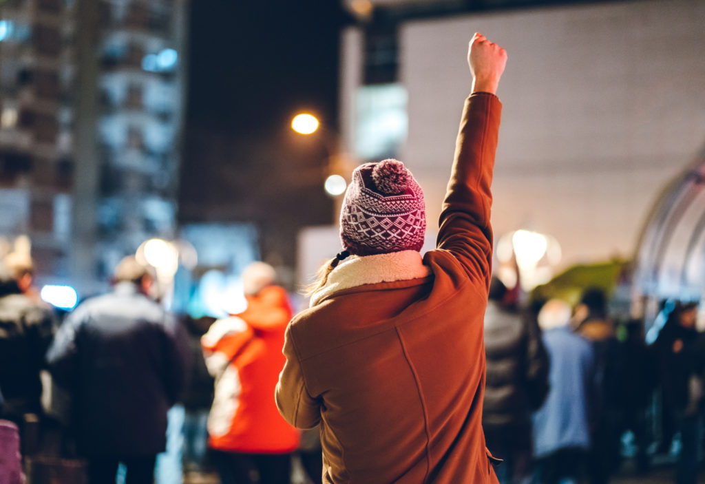 Protester with arm raised